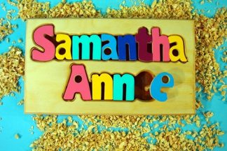 A wooden puzzle with the name Samantha Anne on it.