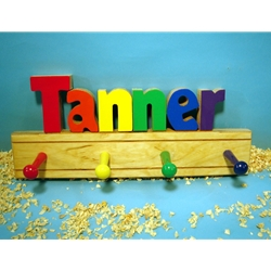 A child's coat rack with the name Tanner on it.