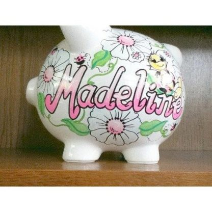 A piggy bank with the name Madeline on it.